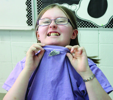 DRE student EmmaLeigh Unroe celebrated mix-match day by turning her shirt inside out and backwards.