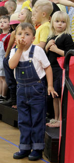 Landon Brewer blows kisses to his family in the audience.