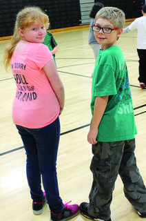 DRE students Alyssa Shephard and Gregory Dorsey wore their T-shirts backwards for mix-match day.