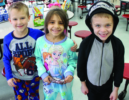 CMZ students Alex McIntosh, Kaylee Howe and Caden Gentry show off their pajamas.