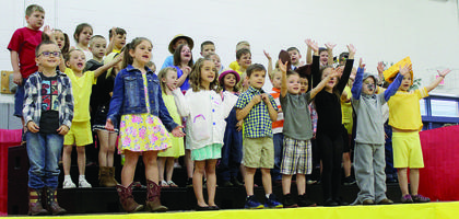 """Dressed for """"Farmer and the Dell,"""" MCE kindergartners perform songs they've worked all year on. Photos by Amanda Kelly"""
