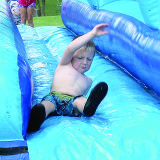 Brody McComas slides towards the pool.