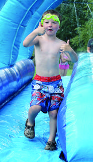 Lucas Rice gives a thumbs-up to Parks and Recreation Director Mattie Gutman before taking a dip in the pool.