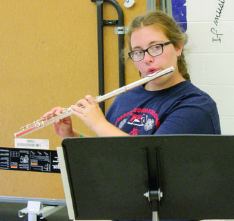 Brianna Prince watches the director during woodwind practice.