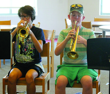 Lilly Fitzpatrick and Wyatt Camacho blare out notes on their trumpets.