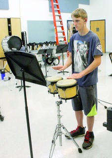 Austin Robison works on learning his music on the drums.
