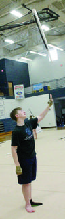 Logan Klette prepares to catch a rifle during color guard training at Grant County's band camp.
