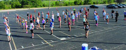 Grant County High School works on their timing while marching forward and backward during band camp July 23 through July 27 at the school before their season starts. Photos by Amanda Kelly