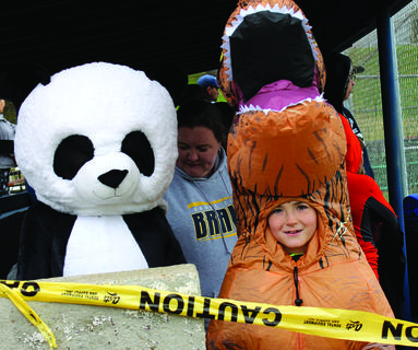 Siblings Mikayla and Clayton Jarrell arrived at Halloween in the Park as a panda and a T-rex.