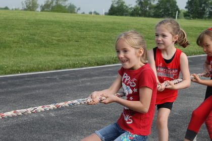 SES student Savannah Stewart participates in Tug-O-War at Sherman Elementary's track and field day.