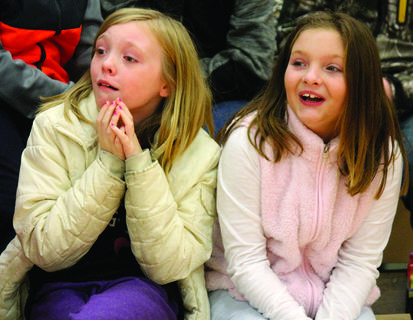 Cassie McIntosh, left, gasps when Zoodles brought out the joey.