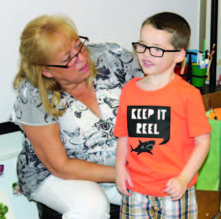Williamstown Elementary's Pam Saylor talks to Jase McCandless during his first week of preschool. Photos by Camille McClanahan, Bryan Marshall and Amanda Kelly