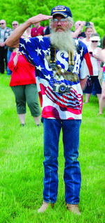 Marine veteran Jerry Sowders, right, salutes during the Memorial Day ceremony May 27 at the Kentucky Veterans Cemetery North in Williamstown. Photos by Mark Verbeck