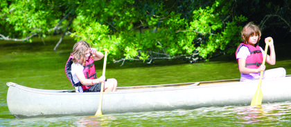 Katlin Muse and Nevaeh Race take a stroll during canoe class at 4-H Camp.