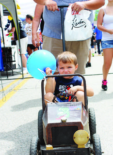 Luke Robbins rides around the car show and vendor street in his own hot rod.