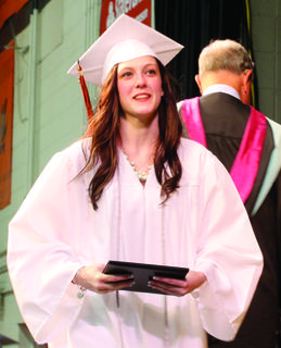 WHS graduate Madison Helton crosses the stage to shake Williamstown Schools Superintendent Misty Middleton's hand.