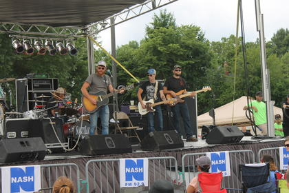 NantzLane Band rocks the stage, getting the early crowd dancing and singing to some country and rock covers.