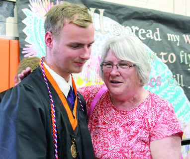 Nick Dalton talks with Theresa Canafax after WHS graduation.