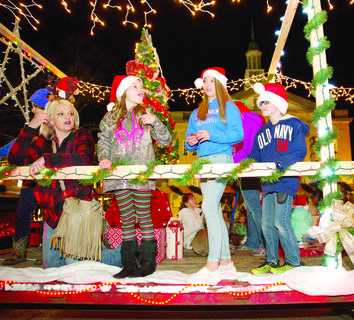 Samantha Parsons, Bailey Parsons, Mariah Meither and Riley Conrad pass out candy to the crowd during the Country Christmas parade.