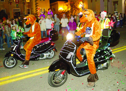 A reindeer decides to ride in style instead of walking in the parade. A Country Christmas was sponsored by the Grant County Chamber and Grant County Tourism.