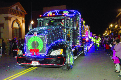 A GeoStabilization International and American lighthouse Transport semi-truck lights up during the parade.