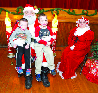 Anthony and Joseph Path pose for a photo with Santa and Mrs. Clause during the Grant County Parks and Recreation Christmas event at the Grant County Park on Dec. 10. Photos by Mark Verbeck
