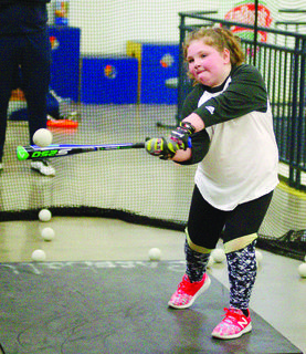 Olivia Martin works on her batting.  Photos by Mark Verbeck