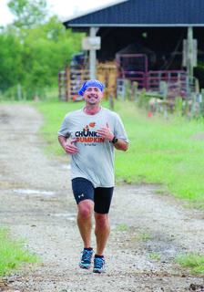 Jeff Voss smiles as he runs toward the finish line.