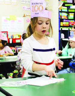 SES student Nova Hendren counts out 100 marshmallows on the 100th day of school.
