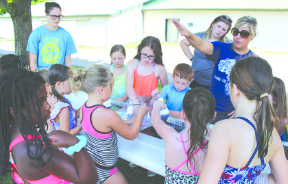 Grant County Parks and Recreation Director Mattie Gutman directs kids during the bubble blowing activity. Photos by Bryan Marshall and Samantha Tamplin