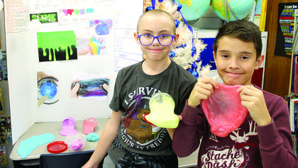Dry Ridge Elementary fifth graders Tyler Jump and Bryant Marshall show off their slime that they sold during the Entrepreneur Fair. Photos by Bryan Marshall