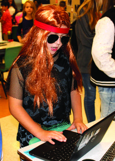 Blake Grissett welcomed visitors to the museum dressed as Axl Rose from the rock band Guns N' Roses during Williamstown Elementary's wax museum presentations Oct. 10. Photos by Bryan Marshall