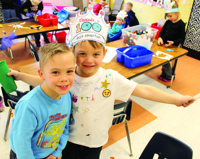 WES students Zachary Savochka and Jakob Owens have fun in kindergarten class on the 100th day.  Photos by Bryan Marshall, Camille McClanahan and Amanda Kelly