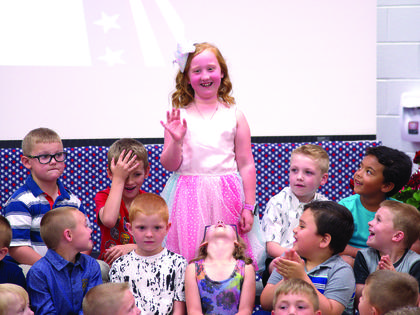 Hadlee Barker waves to the audience during CMZ's kindergarten promotion.