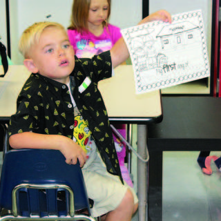 A CMZ student asks a question about the coloring page on his first day of kindergarten.