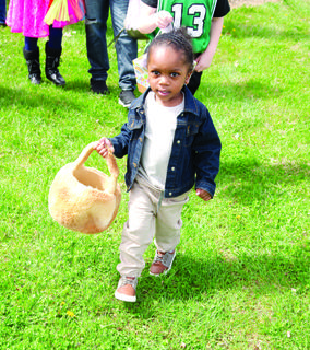 Wyatt Bailey, right, carries her Easter Egg basket.  The Grant County Parks and Recreation and GCPL hosted the egg hunt at the library on April 13 for children ages 2- 10.   Photos by Mark Verbeck