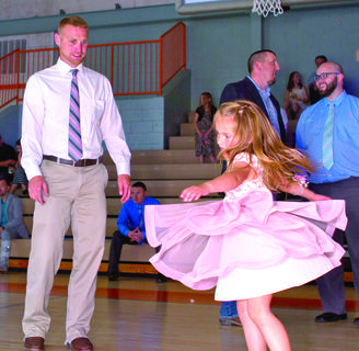 Derrick and his daughter, Emery Holland dance. Photos provided by Sarah Dills and Robin Doyle