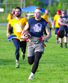 GCSO's Blake Dills runs down the field with the ball. Photos by Mark Verbeck