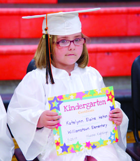 Katelyn Helton shows off her diploma.