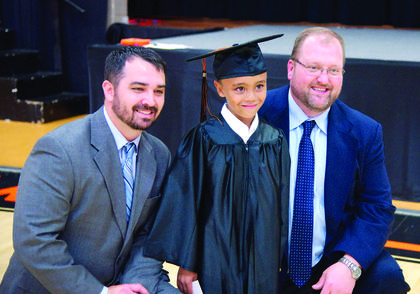 Principal Jeremy Dodd and Mr. Berry pose for a photo with kindergarten graduate Logan Merrill.