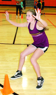 Kadence Hendren participates in defensive drills at the Williamstown basketball camp held on June 10 through June 13.