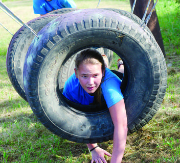 Desiree Palmer conquers the tire obstacles in the 2017 Explore the Mud Run held recently.