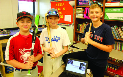 Fifth graders Luke Williams, Kainan Held and Braiden Beach each portray famous baseball players for their wax museum presentations.