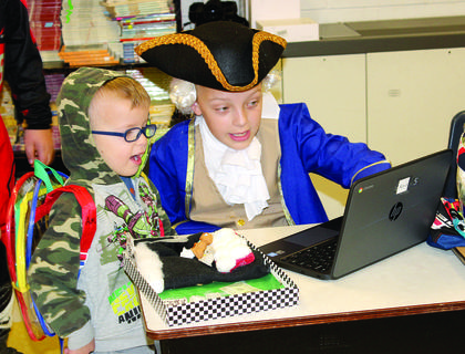 Mandy Dodds teaches a younger student about the first president  — George Washington.