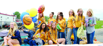 The Grant County High School Girls Basketball team waves to the crowd.  Photos by Mark Verbeck