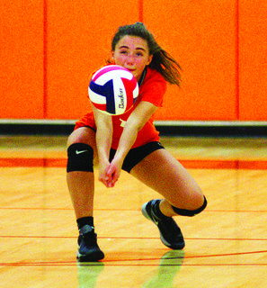 Macy Linder with the dig for the Lady Demons.