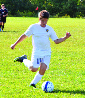 Grant County's George Kleinwachter with a kick.