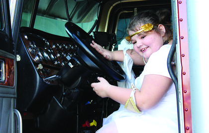 Audrey Bowling honks a horn in an diesel truck. Photos by Camille McClanahan