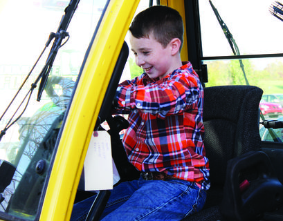 Jacob Rudd checks out the inside of a forklift.