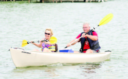 Rob and Nancy Zwick paddle their boat.